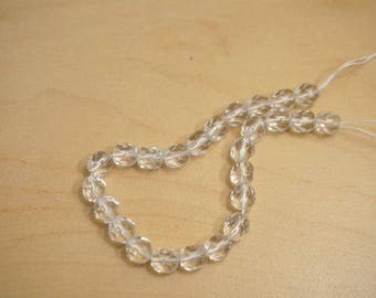 25 beads faceted - transparent 6 mm