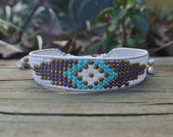 White loom bracelet with round seed beads