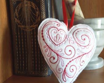 Embroidered stuffed felt heart
