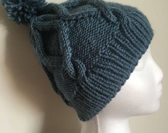 Hourglass cable knit hat; blue cable knit hat; hat with pom pom