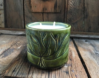 Vanilla scented soy candle in handmade ceramic candle holder