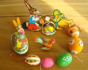 Vintage set of Easter decorations. (Eggs, figurines from a cardboard and wood).