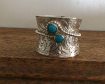 Gorgeous handmade sterling silver ring with two 4mm turquoise cabochon