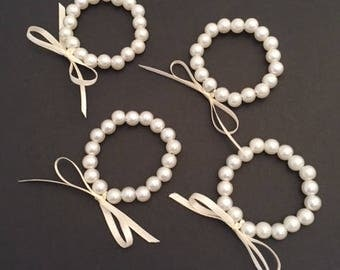 Cream Faux Pearl Napkin Rings with bow embellishment