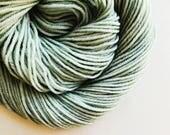 VERDIGRIS hand dyed yarn fingering sock dk bulky yarn super wash merino wool yarn single or ply. you choose your base. light grey gray green