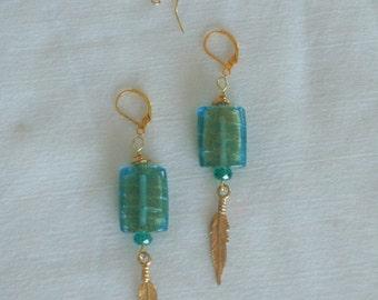 Earrings Ocean Green . Drop dangle earrings. Foil infused bead, Gold feather dangle. Handmade . Drops 3 inches from earlobe . Jewelry Gift