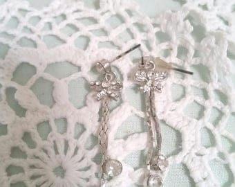 vintage bow earrings, 90s does 70s, dangle rhinestone earrings, silver rhinestones, silver bow earrings