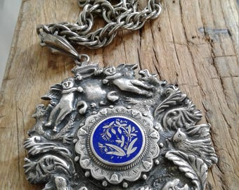 60s ORNATELY CARVED PENDANT Necklace—Blue Enamel Center Medallion—Heavy and Weighty—Cherubs, Birds, a Lion, Eagles—Amazing Quality
