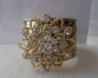 Gold Tone Cuff Bracelet with Clear Crystal Beads in a Gold Tone frame