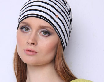Beanie- That's the essential that will catch everyone's eyes because of its expressive pattern