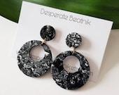 Black lucite hoops earrings