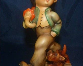 "Antique M I Hummel Figurine ""Strolling Along"" 1959 TMK3 Current Value = 250 dollars. Get this one at 50% off."