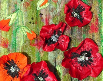 poppies. small wall hanging. textile art fibre art fabric flowers red and green.