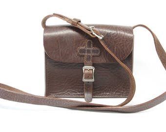 Leather shoulder bag, hand-stitched, with cross motif