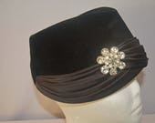 1950s Women's Hat Styles & History Ranleigh Black Felt Hat with Wraparound Black Silk Ribbons and Rhinestone Silver Brooch made in France 1950s $18.00 AT vintagedancer.com