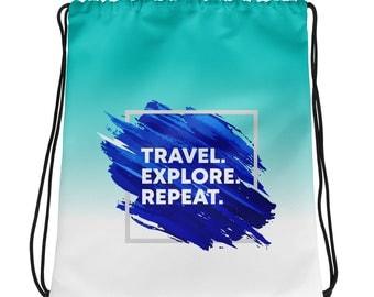 Travel. Explore. Repeat. Drawstring Bag