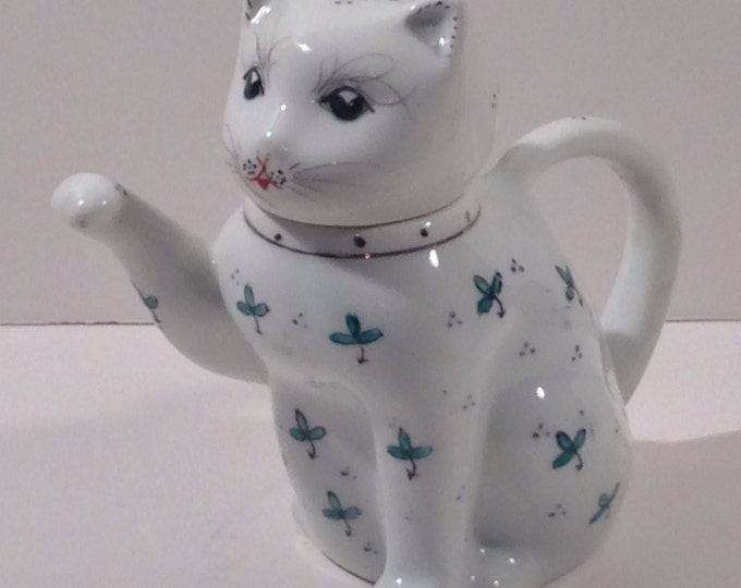 Vintage Chinese Ceramic Cat Teapot in White with Green Accents and a Gold Collar offered by Crafts by the Sea at Island Images Studio.
