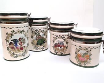 FARMHOUSE CANISTER SET is a Graduating Set of 4 Green & White Bail Wire Stoneware Canisters Each Decorated with a Different Farm Scene