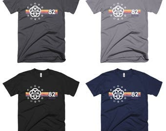 EPCOT Shirt - EPCOT Center T-Shirt with Pavilion Logos and a Yellow, Orange, Red, Purple Stripe Rainbow - A Retrocot Original