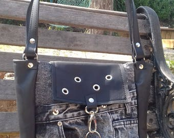 Small grey jeans and black leather bag