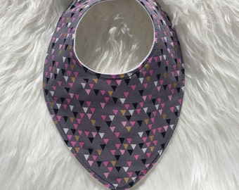 Pink, grey, black and white triangle dribble and drool bib for babies and toddlers