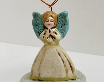 Angel's photo-gallery in terracotta and copper