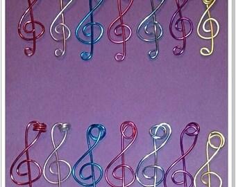 Treble clef of different size pendants