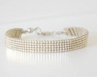 Bracelet weaved in pearls Miyuki delicas plain color Chrome