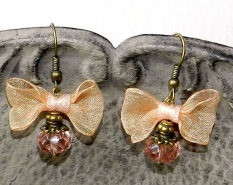 These glamorous earrings peach color