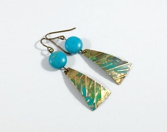 Earrings: embossed with green gold patina + magnesite beads