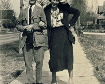 Vintage photograph of couple in comic pose. 1923.