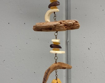 Driftwood sun-catcher with wood and shell accents.