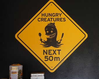 Funny road sign Hungry Creatures