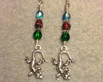 Silver lizard charm dangle earrings adorned with green, red, and turquoise Czech glass beads.
