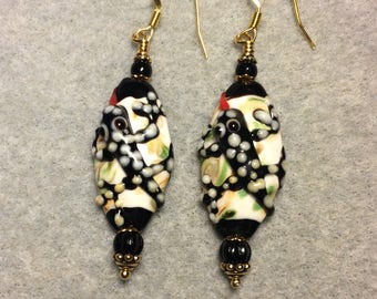 Tiger salamander lampwork bead earrings adorned with black Czech glass beads.