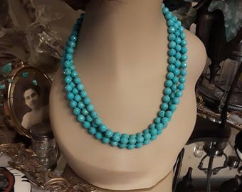 Turquoise three strand beaded necklace