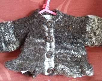 Hand knitted cardigan,  knitted with home spun wool, to fit a baby girl aged 0-3 months old