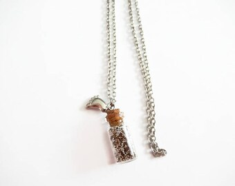 glass flask, metal beads necklace
