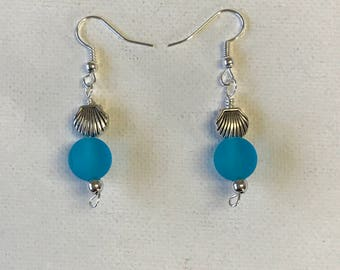Blue Sea Glass Dangling Earrings With Silver Shell Charm