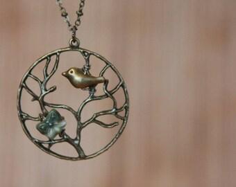 Collier oiseau antique bronze