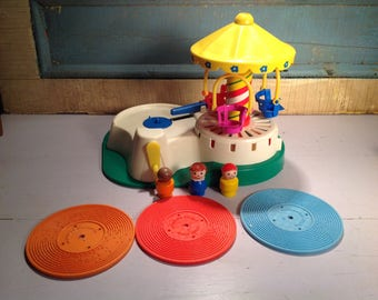 Vintage Fisher Price Change-a-tune carousel with records