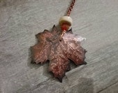 Reserved for Erica-long copper necklace with maple leaf pendant