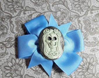Blue loop with cabochon-skeleton woman