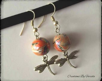 wave earrings with a Dragonfly pendant and a Pearl orange effects
