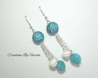Dangle earrings with blue/turquoise rhinestone beads