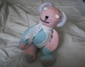 little bear made with needles in blue, pink and white cotton