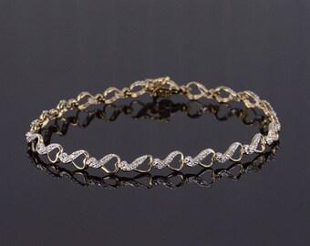 "10k Diamond Heart Infinity Link Tennis Bracelet Gold 7.5"""