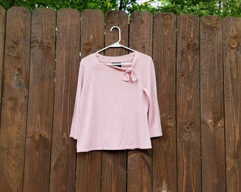 vtg blush pink jersey knit women's sweater w/ three-quarter sleeves and tieable neckline