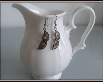 Bronze mask earrings,