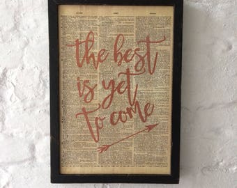 "Framed wooden sign with vintage dictionary page and ""The best is yet to come"" quote"
